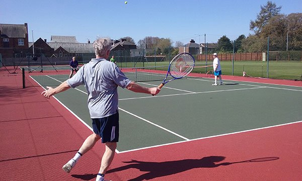 Social tennis members playing on the hard courts