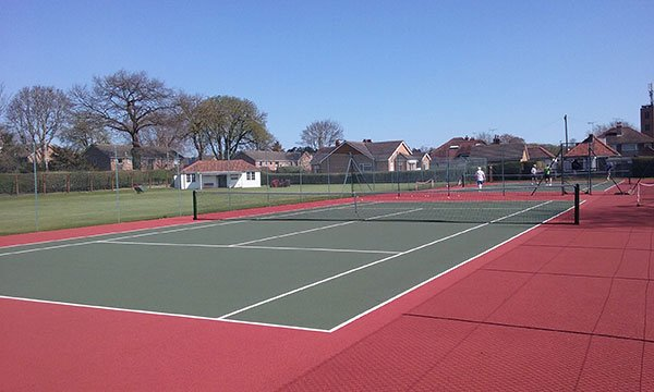 Social tennis being playing on one of the two hard courts at Driffield LTC