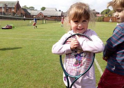little-girl-holding-racket-driffield-lawn-tennis-club-nature-valley-big-weekend-19-may-2019
